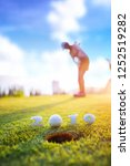 Small photo of incoming year 2019, prepare by putting of woman golfer on the green, golfball mostly ready to drop into the hole of new year success, Happy new year and merry Christmas on golf course