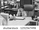 boy sits in the office in the... | Shutterstock . vector #1252567498