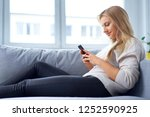 young woman using smartphone... | Shutterstock . vector #1252590925