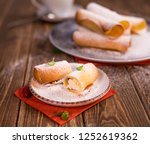 delicious pastries on a plate.... | Shutterstock . vector #1252619362