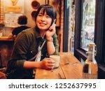 asian woman drinking coffee in  ... | Shutterstock . vector #1252637995