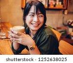 asian woman drinking coffee in  ... | Shutterstock . vector #1252638025