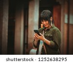 asian woman using smartphone... | Shutterstock . vector #1252638295