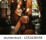 asian woman drinking coffee in  ... | Shutterstock . vector #1252638358