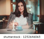 beautiful woman sitting at the... | Shutterstock . vector #1252646065