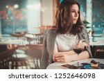 beautiful woman sitting at the... | Shutterstock . vector #1252646098