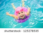 Funny Little Girl Swims In A...