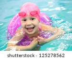 funny little girl swims in a... | Shutterstock . vector #125278562