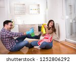 happy young couple sitting on... | Shutterstock . vector #1252806292