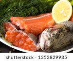 slices of raw trout for soup. | Shutterstock . vector #1252829935