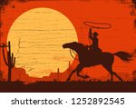 silhouette of a cowboy riding... | Shutterstock .eps vector #1252892545
