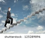 businessman stepping up a... | Shutterstock . vector #125289896