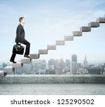 Businessman Stepping Up A...