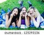 girlfriends having fun lounging ... | Shutterstock . vector #125293136