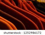 fleece jackets hanging in row... | Shutterstock . vector #1252986172
