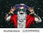 portrait of a cool punk santa... | Shutterstock . vector #1252994902