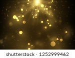 sparkling golden dust  glowing... | Shutterstock .eps vector #1252999462