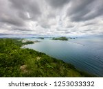 beautiful beach and sea in... | Shutterstock . vector #1253033332