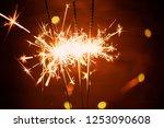 sparklers on a dark background  ... | Shutterstock . vector #1253090608