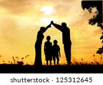 happy parents making home for... | Shutterstock . vector #125312645