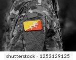 flag of bhutan on soldiers arm. ... | Shutterstock . vector #1253129125