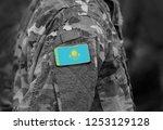 flag of kazakhstan on soldiers... | Shutterstock . vector #1253129128