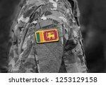 flag of sri lanka on soldiers... | Shutterstock . vector #1253129158