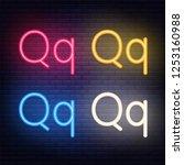 neon letters  font on dark blue ...   Shutterstock .eps vector #1253160988