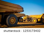 four large yellow trucks used... | Shutterstock . vector #1253173432