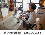 smiling asian businessman in... | Shutterstock . vector #1253201155