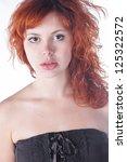 pretty red haired girl on white ... | Shutterstock . vector #125322572