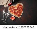 Heart shaped pizza with...