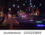 trees lit up in christmas... | Shutterstock . vector #1253252845