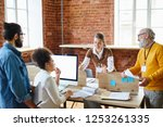 young manager explaining... | Shutterstock . vector #1253261335
