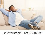 lazy weekend at home. young... | Shutterstock . vector #1253268205