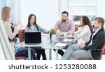 business team discussing the... | Shutterstock . vector #1253280088