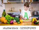 the young boy in cooking... | Shutterstock . vector #1253291905