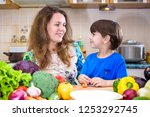 the young cook mother standing... | Shutterstock . vector #1253292745