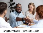 diverse businesspeople during... | Shutterstock . vector #1253310535