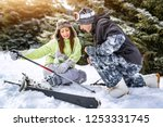 young man snowboarder helps a... | Shutterstock . vector #1253331745