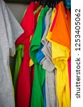 colorful shirts hanging on the... | Shutterstock . vector #1253405062