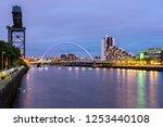 clyde arc bridge along river... | Shutterstock . vector #1253440108