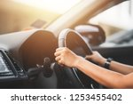 close up of woman driving a car ... | Shutterstock . vector #1253455402