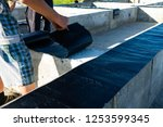 workers carry out waterproofing ... | Shutterstock . vector #1253599345