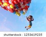 happy kid boy having fun flying ... | Shutterstock . vector #1253619235