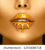 gold paint drips from the lips  ... | Shutterstock . vector #1253688718