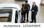 car dealer exaplining a car's...   Shutterstock . vector #1253693845