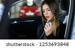 young woman fastening seat belt   Shutterstock . vector #1253693848