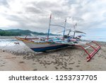 boat on the beach in coron ... | Shutterstock . vector #1253737705