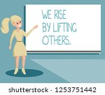 writing note showing we rise by ... | Shutterstock . vector #1253751442